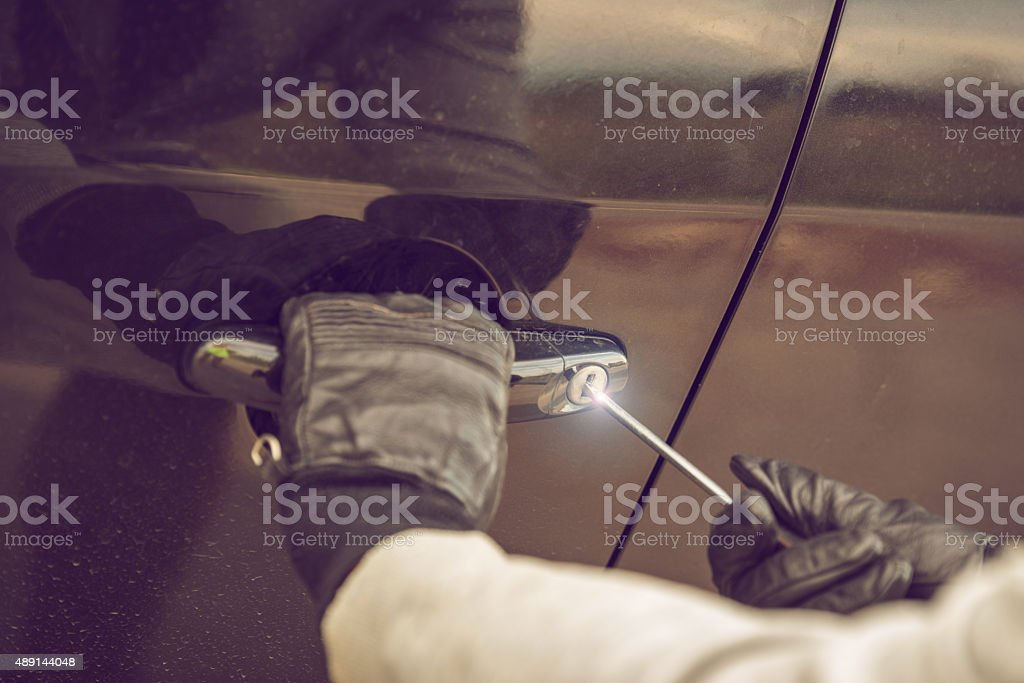 Car Thief stealing a car stock photo