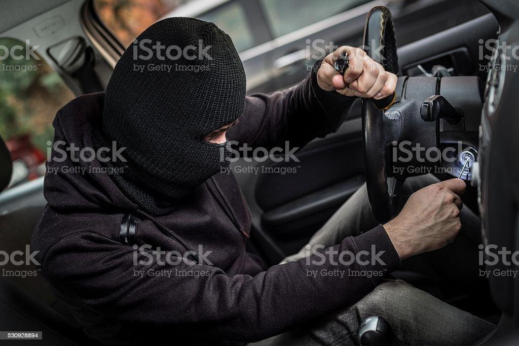 Car Thief tries to start the car stock photo