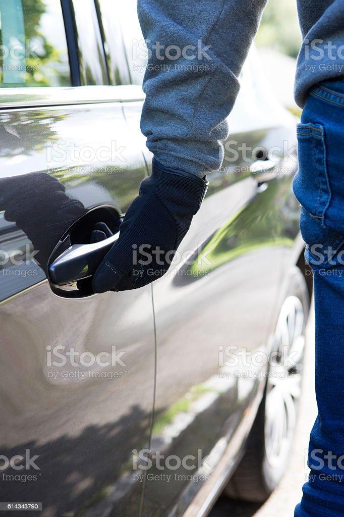 Car Thief Trying Door Handle stock photo