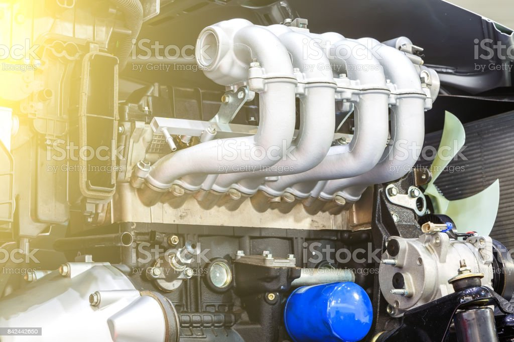 Car timing chain in cutaway engine stock photo