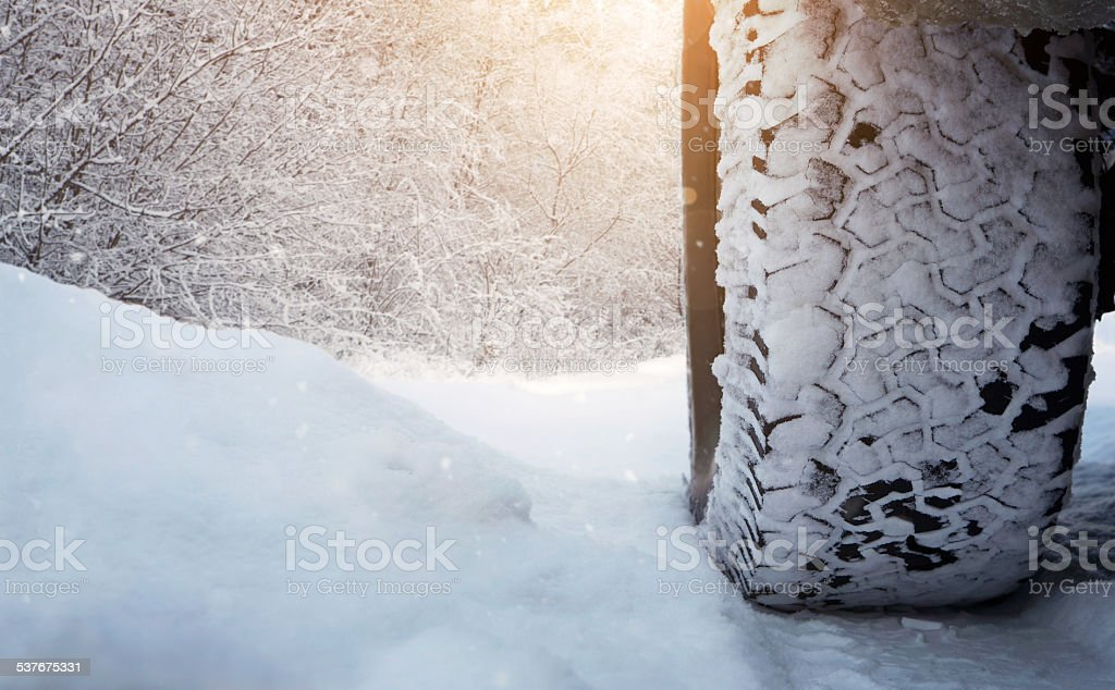 Car tire on the winter road stock photo