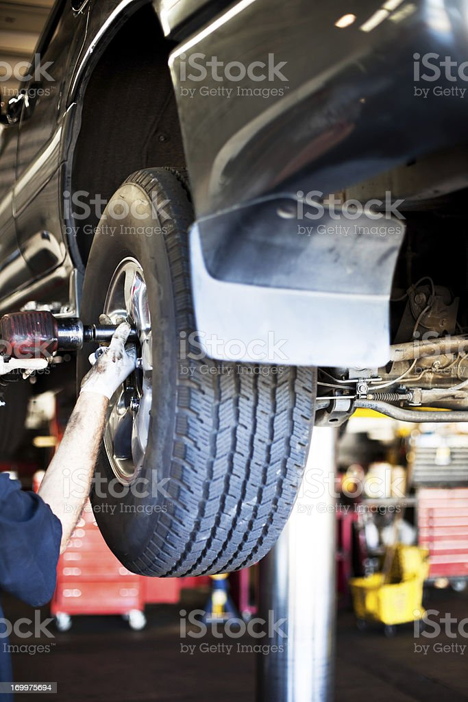 Car Tire Removal royalty-free stock photo