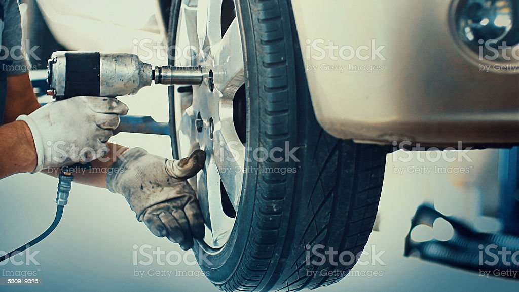 Car tire replacement. stock photo