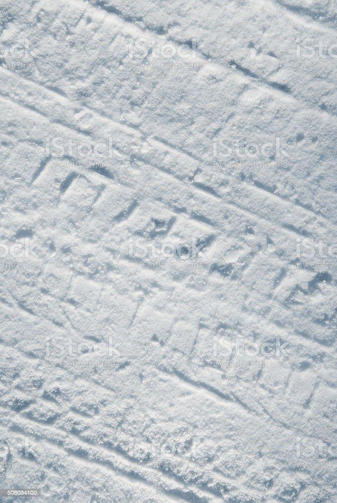 Car tire tracks in snow stock photo