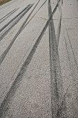 Car tire tracks on the street