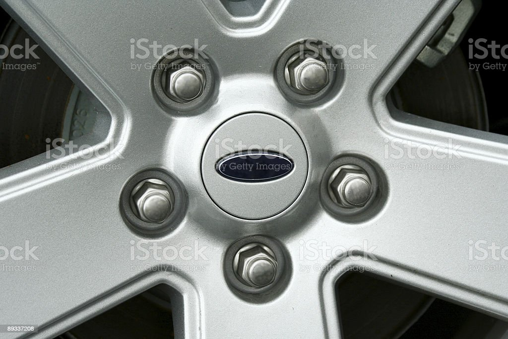Car tire wheel and lug nuts stock photo