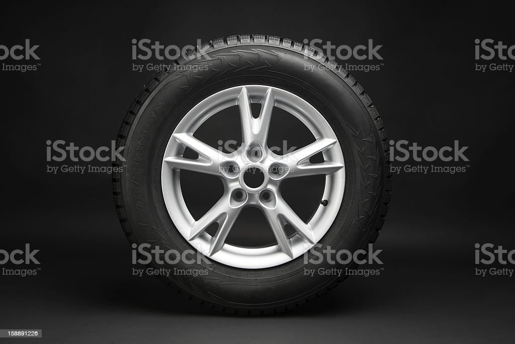 car tire with aluminum alloy wheel stock photo