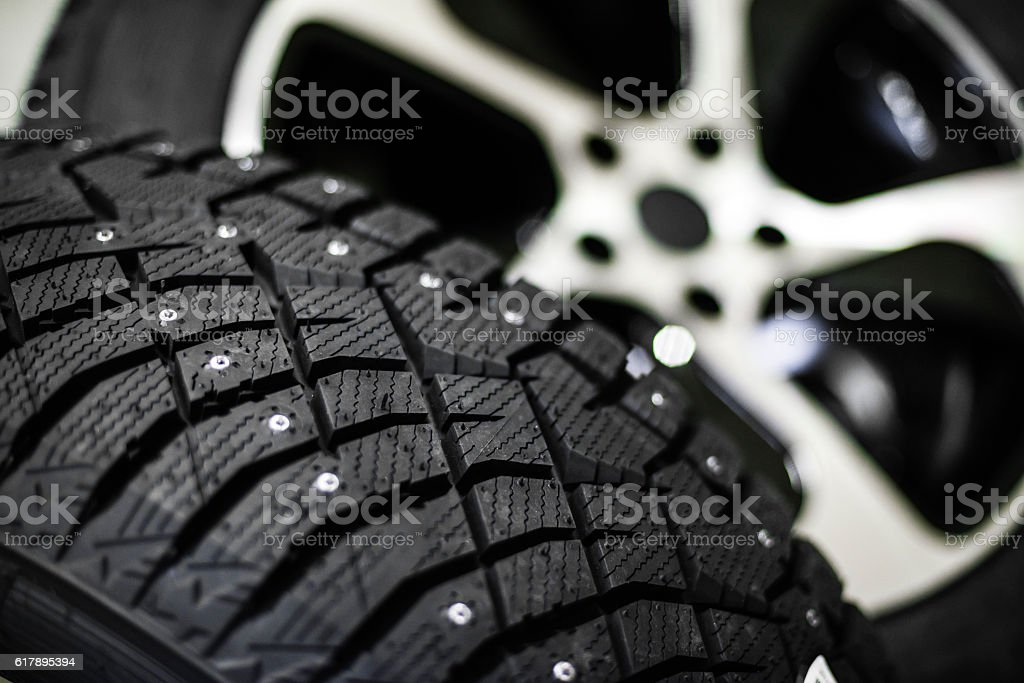Car tire with shallow depth of field stock photo