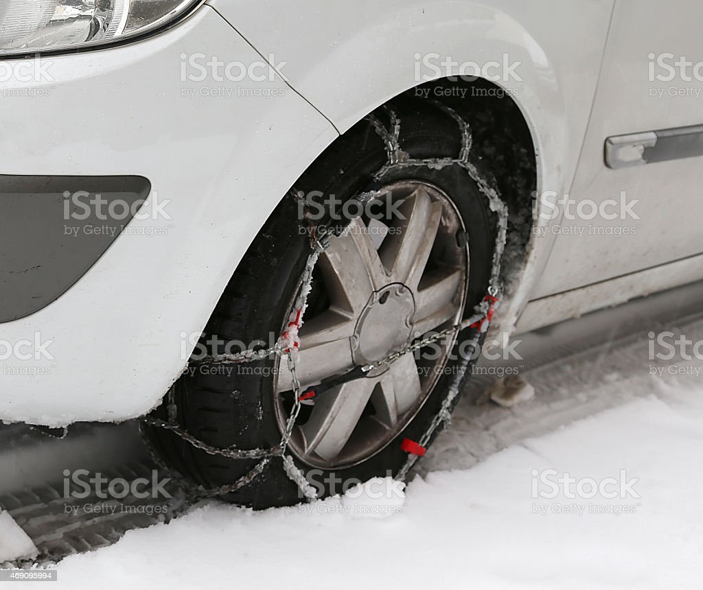 car tire with snow chains in winter stock photo