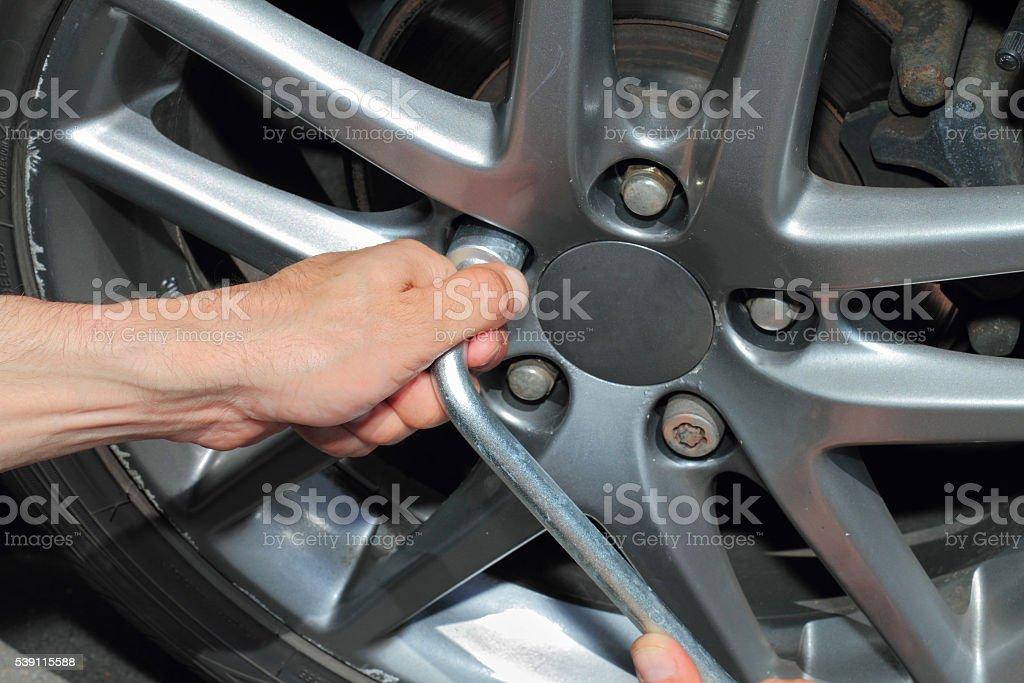 Car tires changing close up stock photo