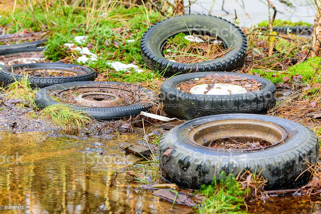 Car tires in nature stock photo