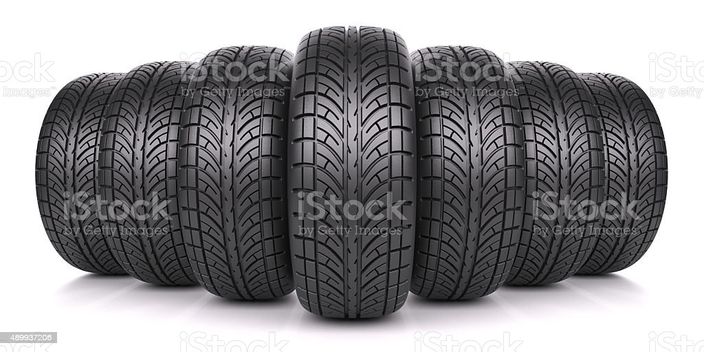 Car tires in row stock photo