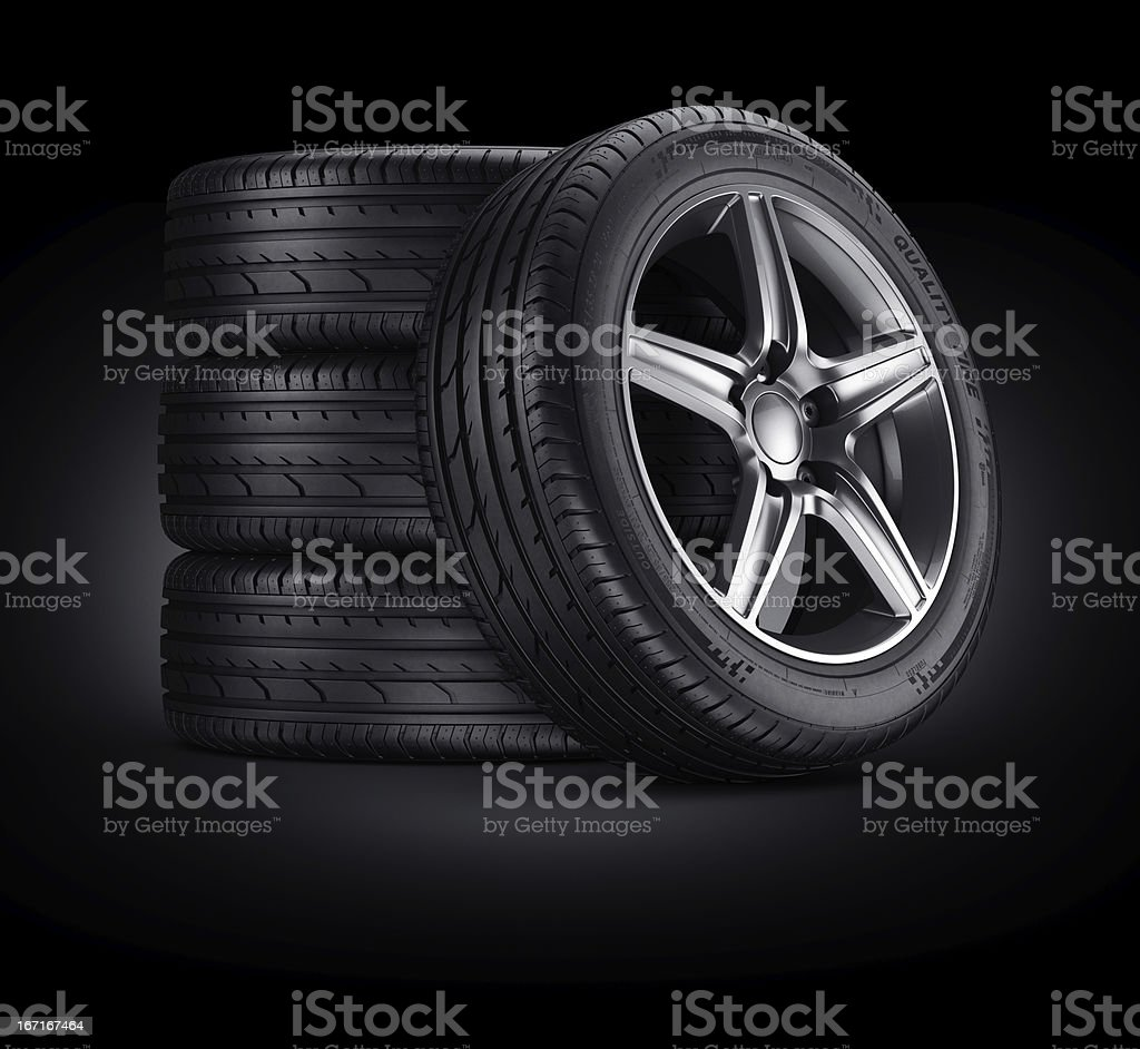 Car tires on black background royalty-free stock photo