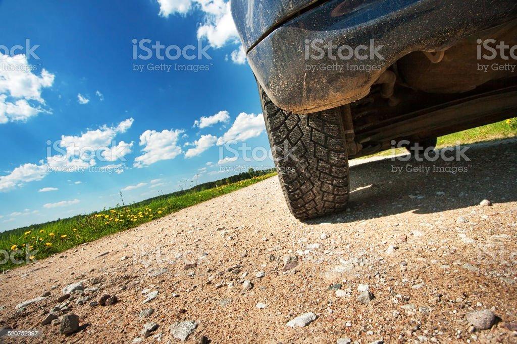 Car tires on gravel goad stock photo