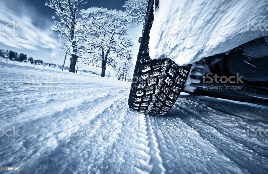 Car tires on winter road royalty-free stock photo