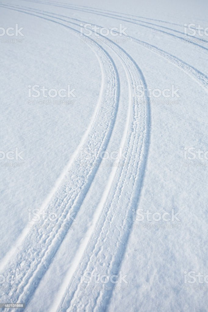 car track on snow stock photo