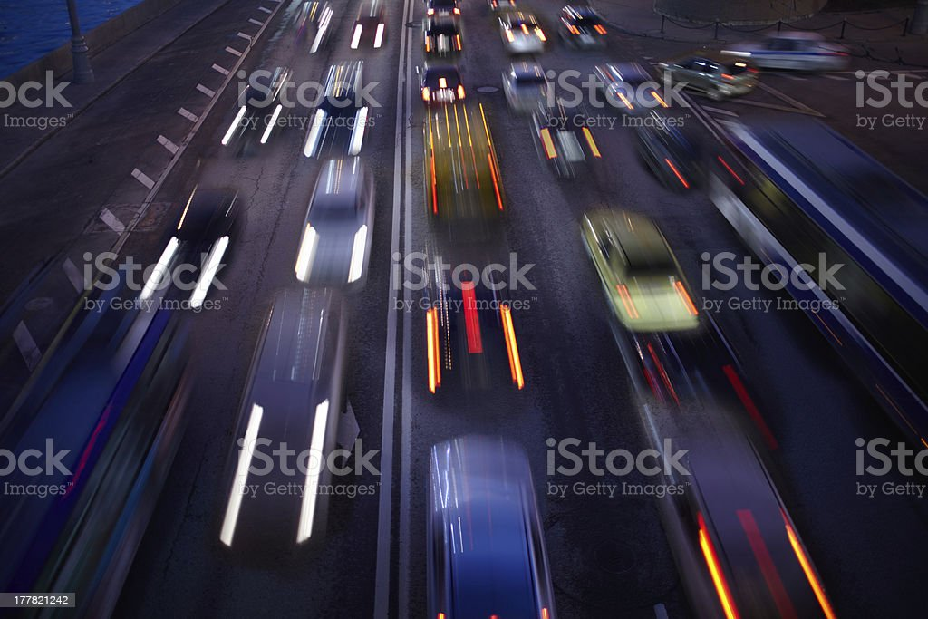 Car traffic at night. Motion blurred background. royalty-free stock photo