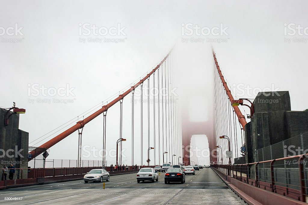 Car traffic on Golden Bridge in a mist, San Francisco stock photo