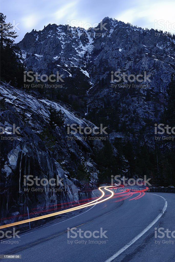 Car trails on a windy mountain road stock photo