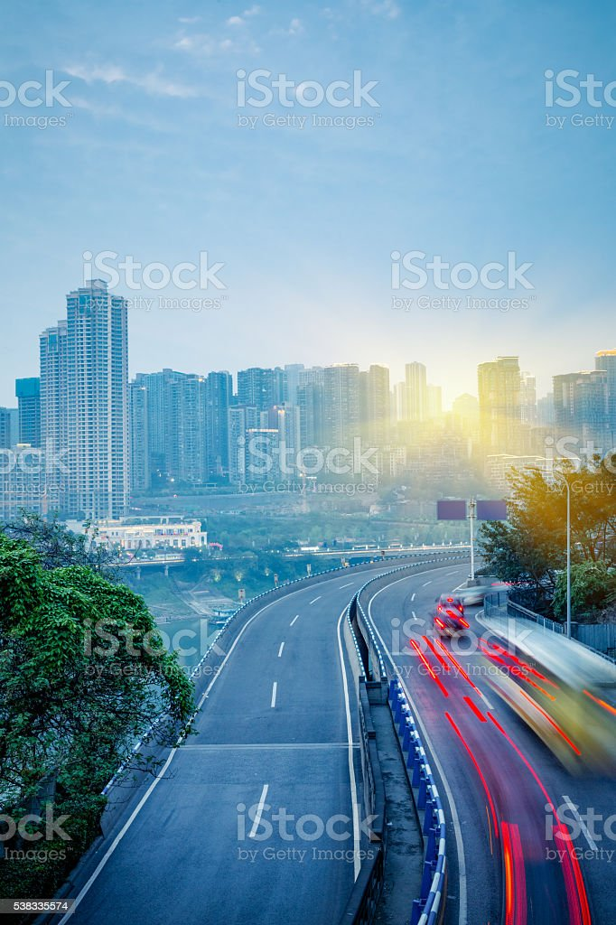 car trails on highway stock photo