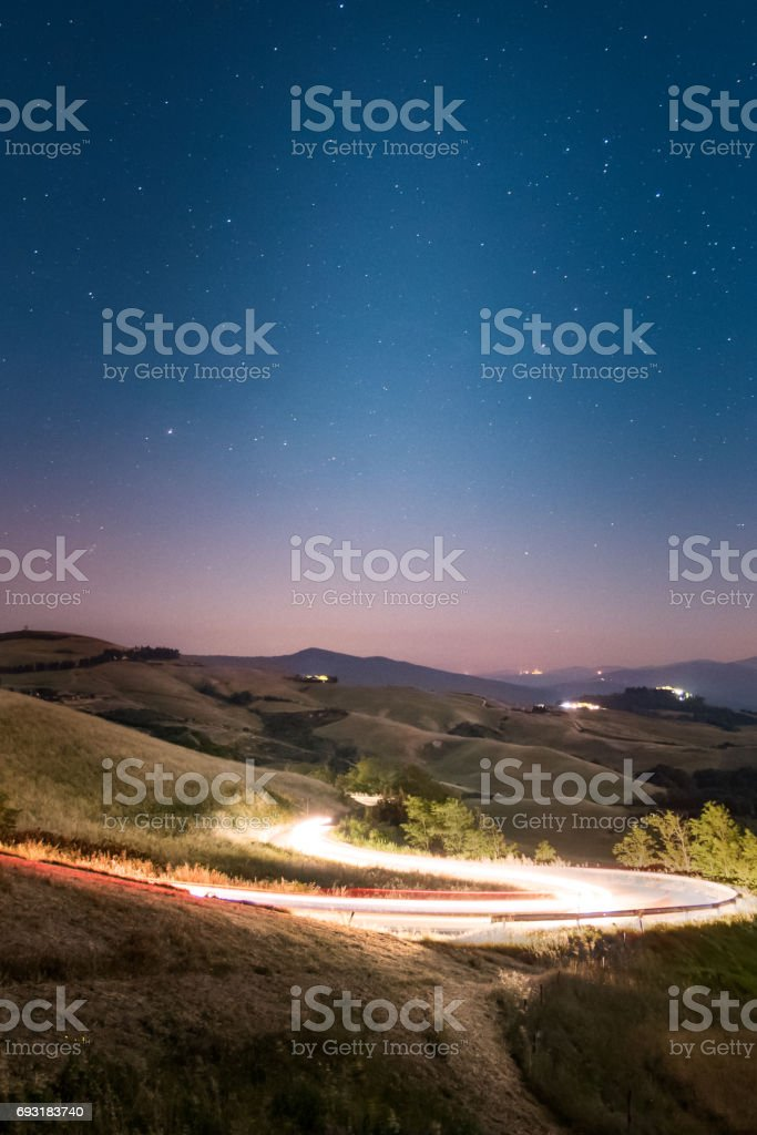 Car trails under the stars stock photo