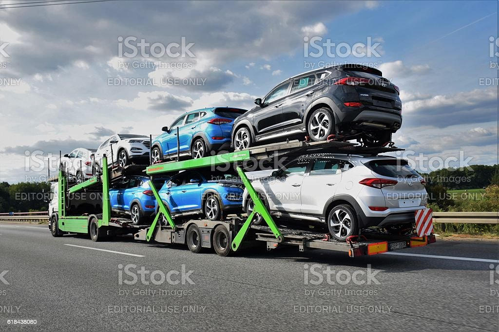 Car transporter driving on the highway stock photo