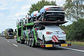 Car transporters driving on the highway