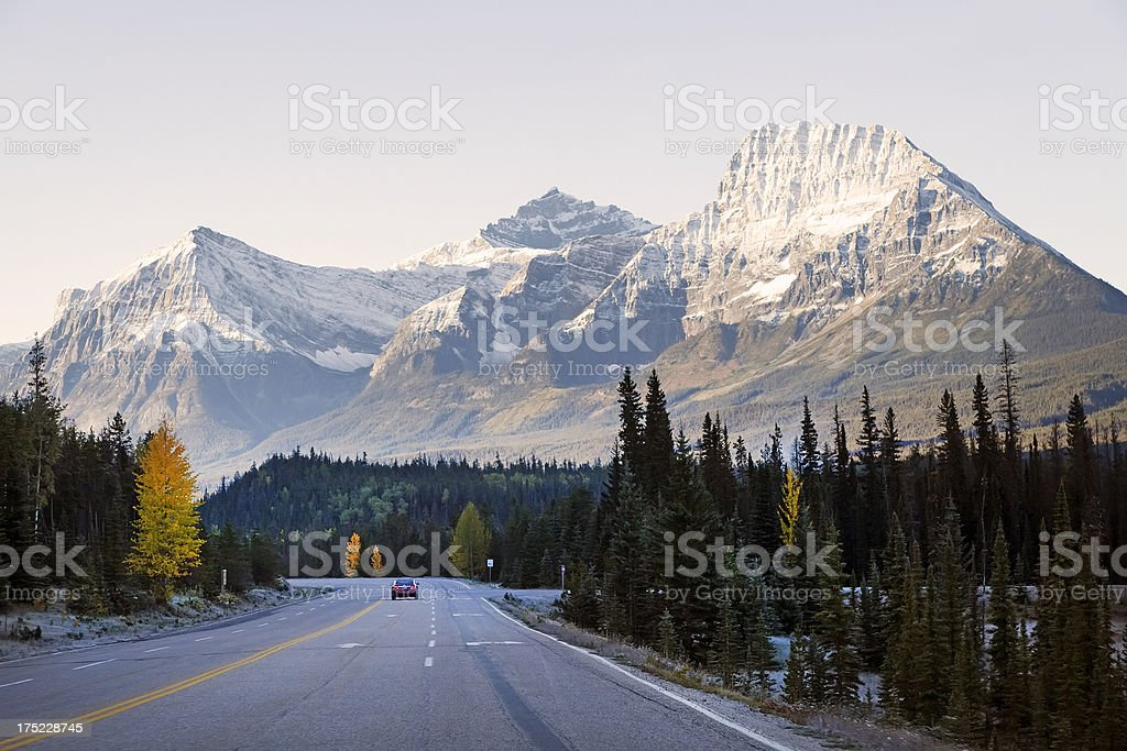 Car traveling icefield Parkway, Canada, in late aftgernoon stock photo