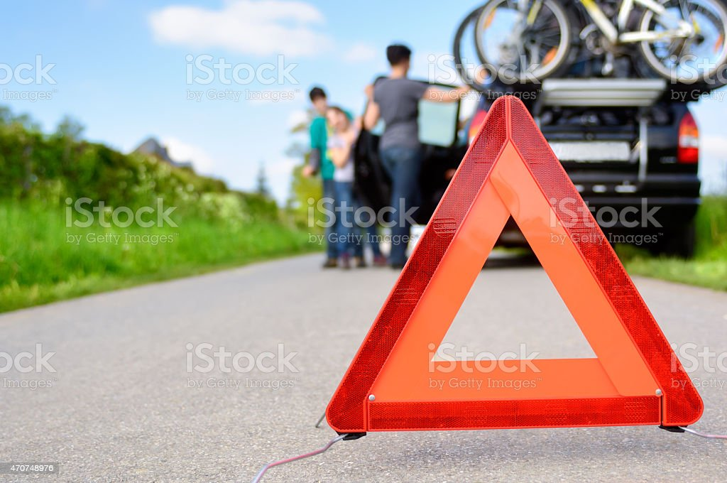 Car trouble hazard triangle on a highway stock photo