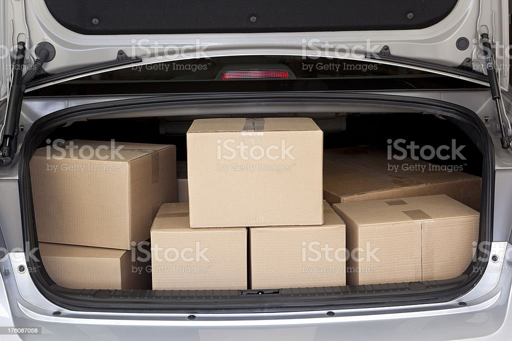 Car Trunk Full of Boxes stock photo