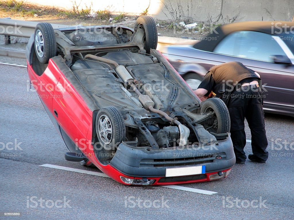 Car turned upside down in an accident stock photo