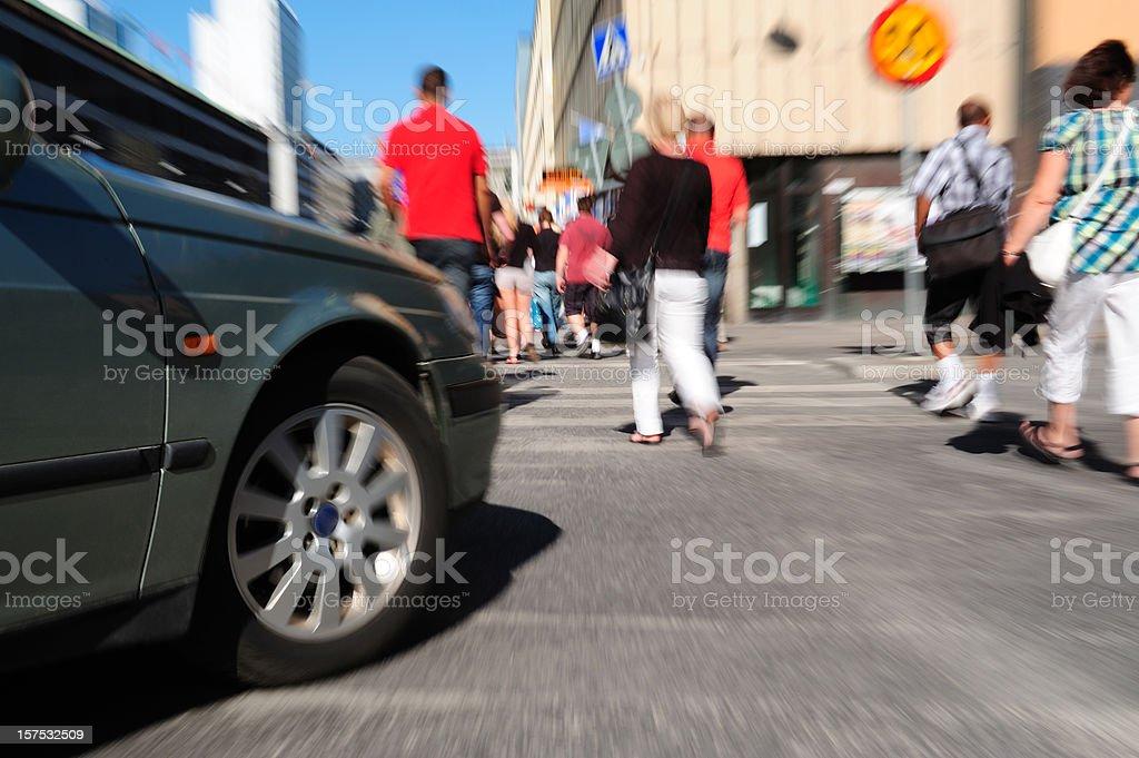 Car turning on zebra crossing stock photo
