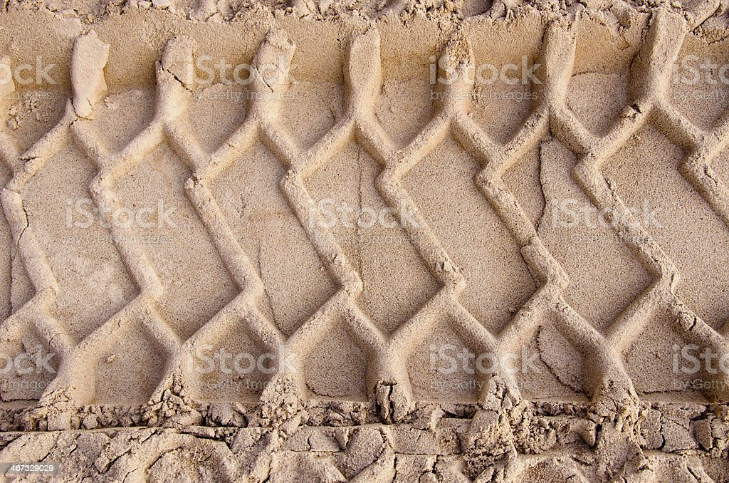 car tyre traces on sand background stock photo
