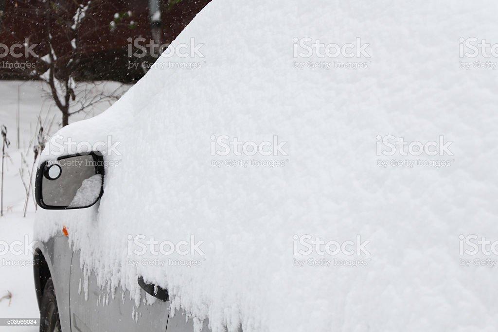 car under a snowdrift stock photo