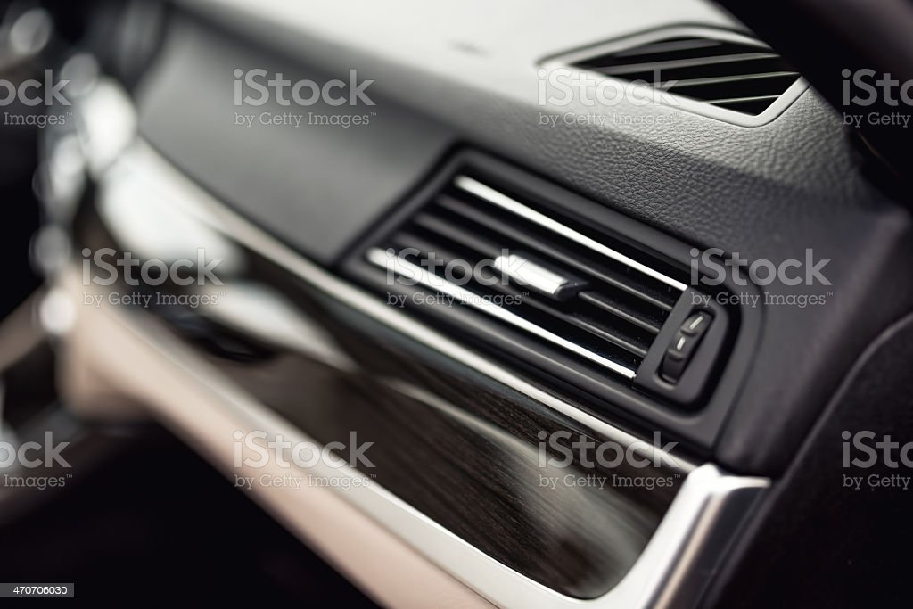 Car ventilation system with adjustment buttons and details, modern car stock photo