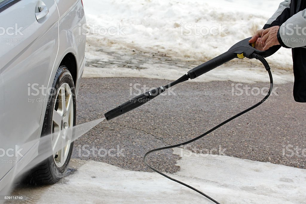 Car wash in winter stock photo