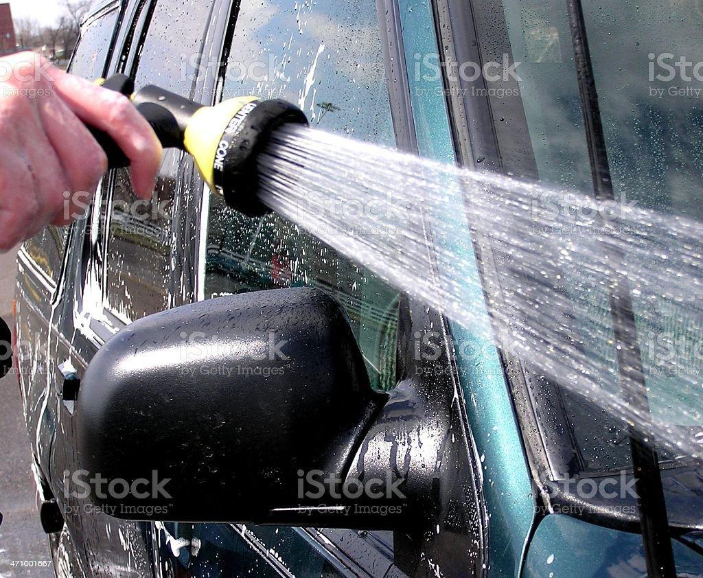Car wash spray hose royalty-free stock photo