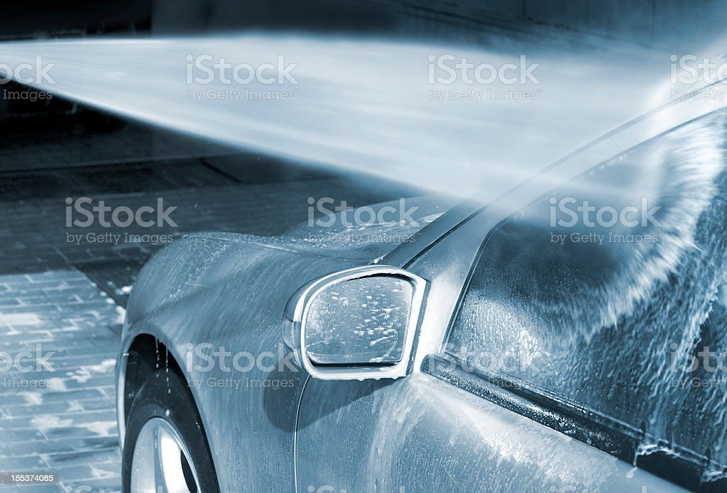 Car Wash with high pressure cleaner stock photo