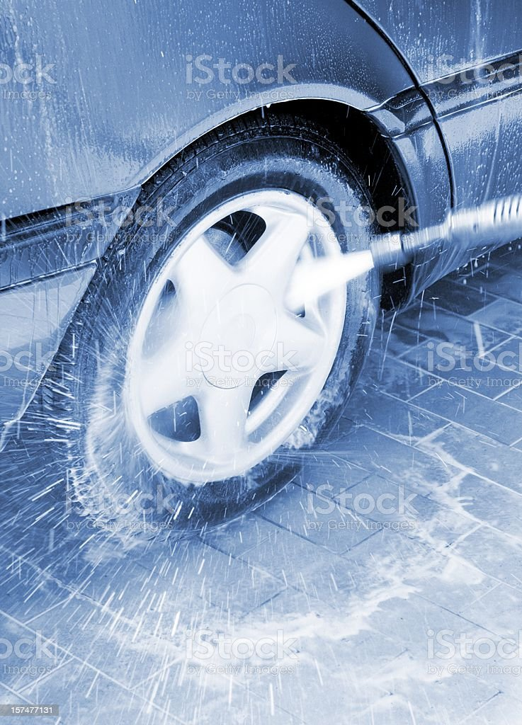 car wash with high pressure washer stock photo