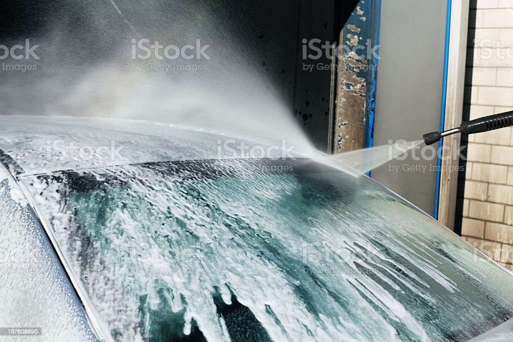 Car wash with high-pressure cleaner royalty-free stock photo