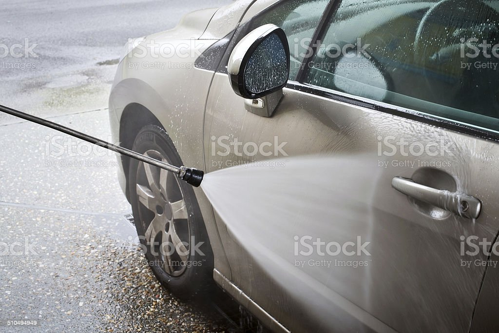 Car washing with a high pressure water jet stock photo