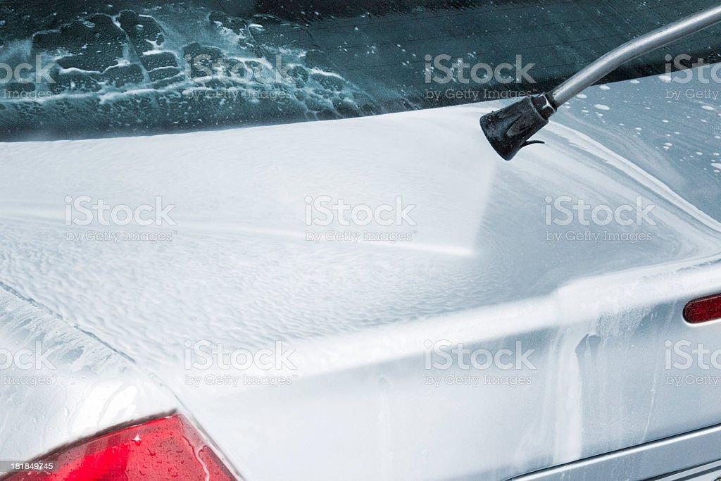 Car washing with sprayed water stock photo