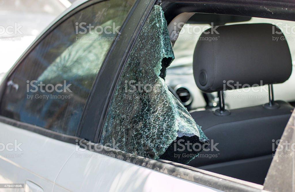 Car window smashed, close-up - Stock Image stock photo