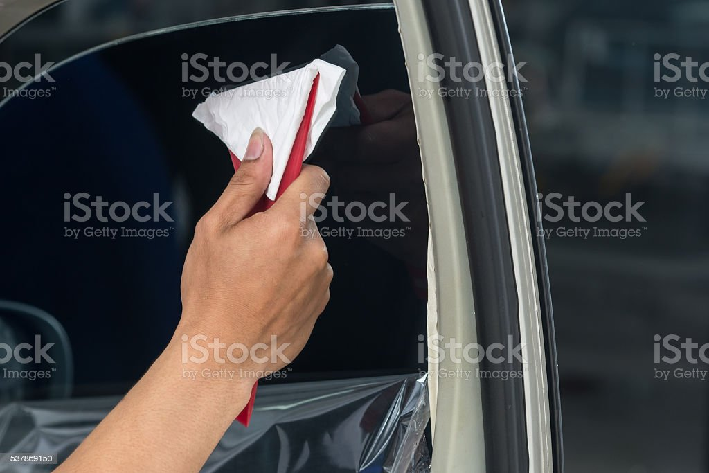 Car window tinting series : Installing car window tint stock photo