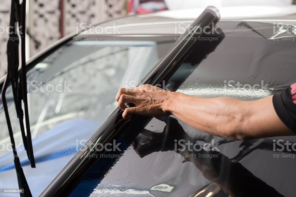 Car window tinting series : Installing car window tint stock photo