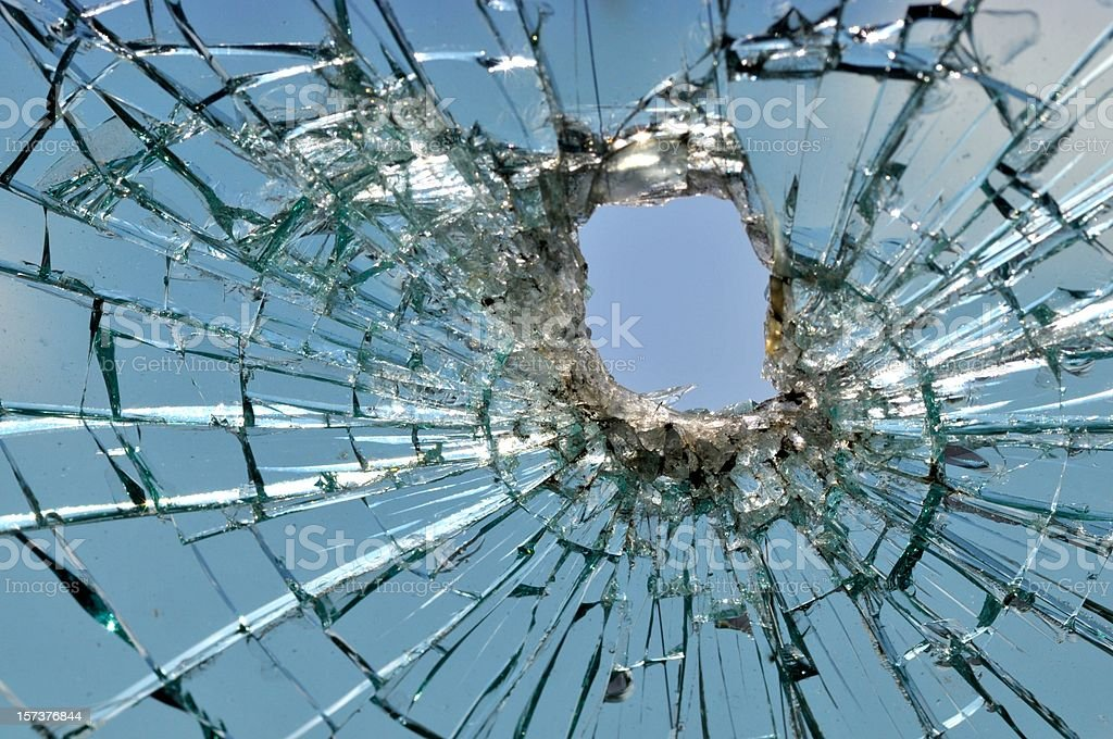 Car windshield shattered by a bullet royalty-free stock photo