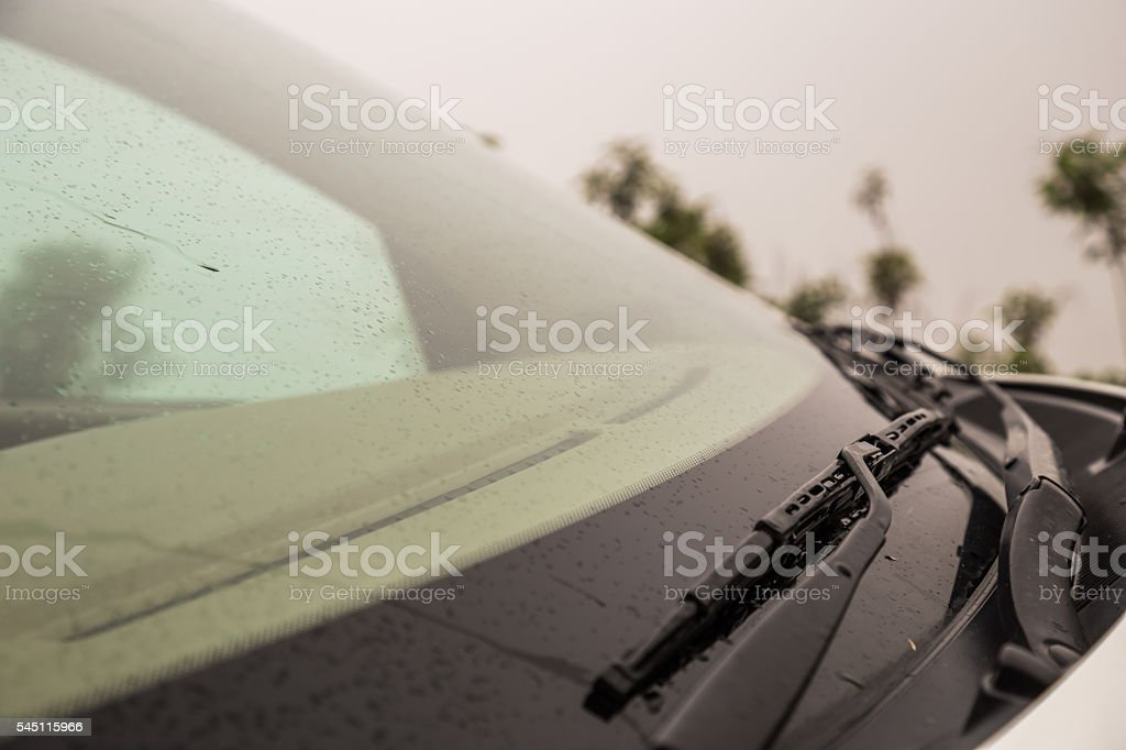 Car wipers on windshield stock photo