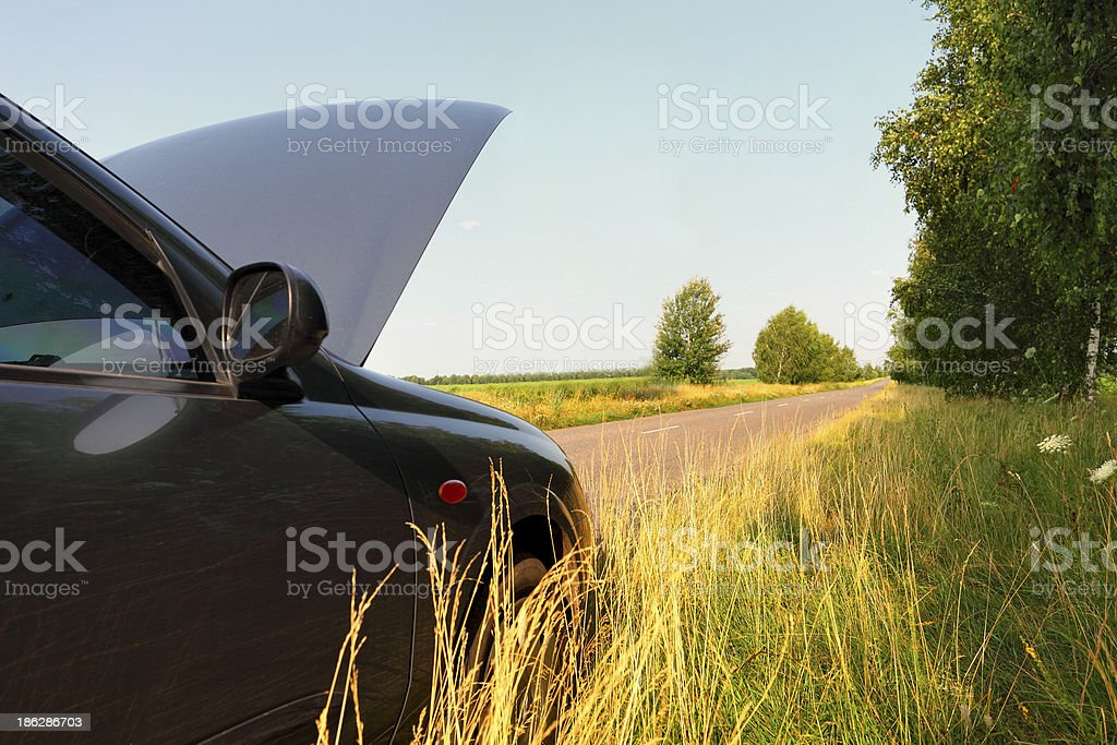 car with opened hood outdoors royalty-free stock photo