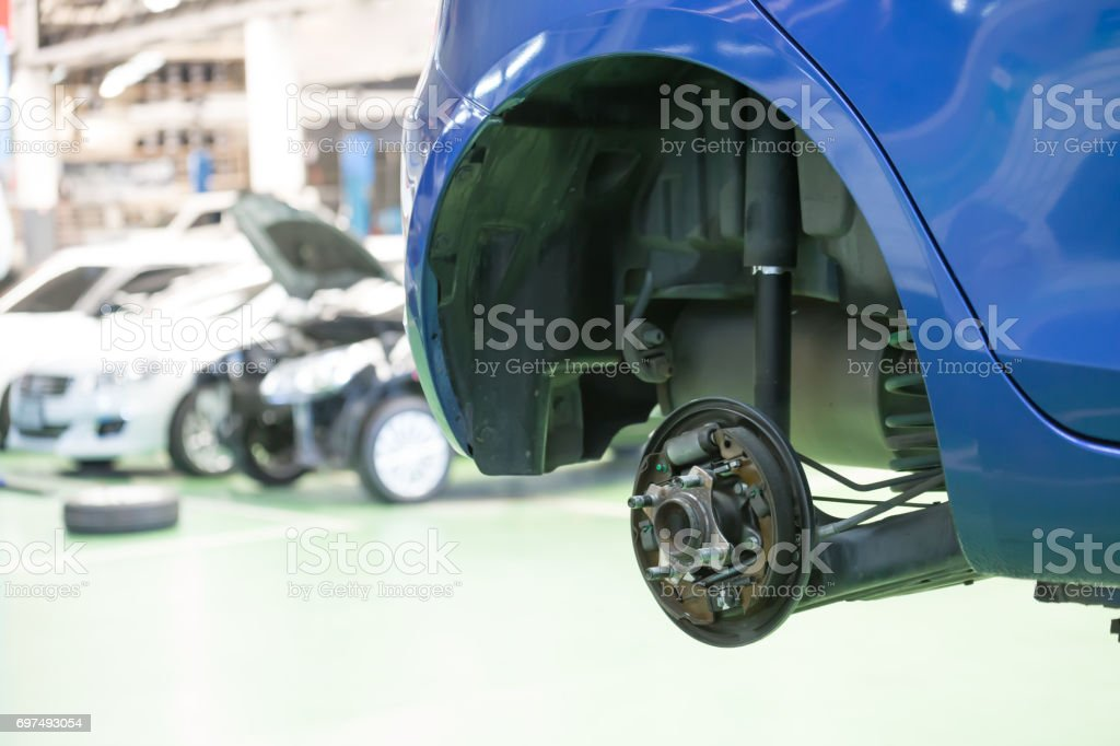 Car with removed wheel stock photo