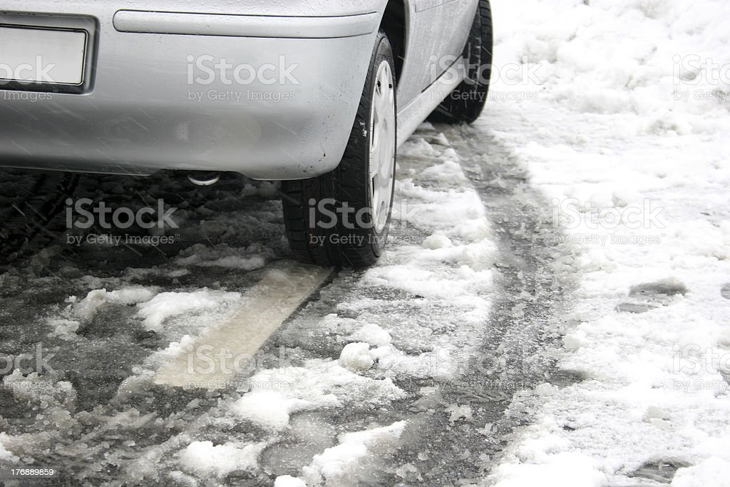 Car with skidmark in the snow stock photo